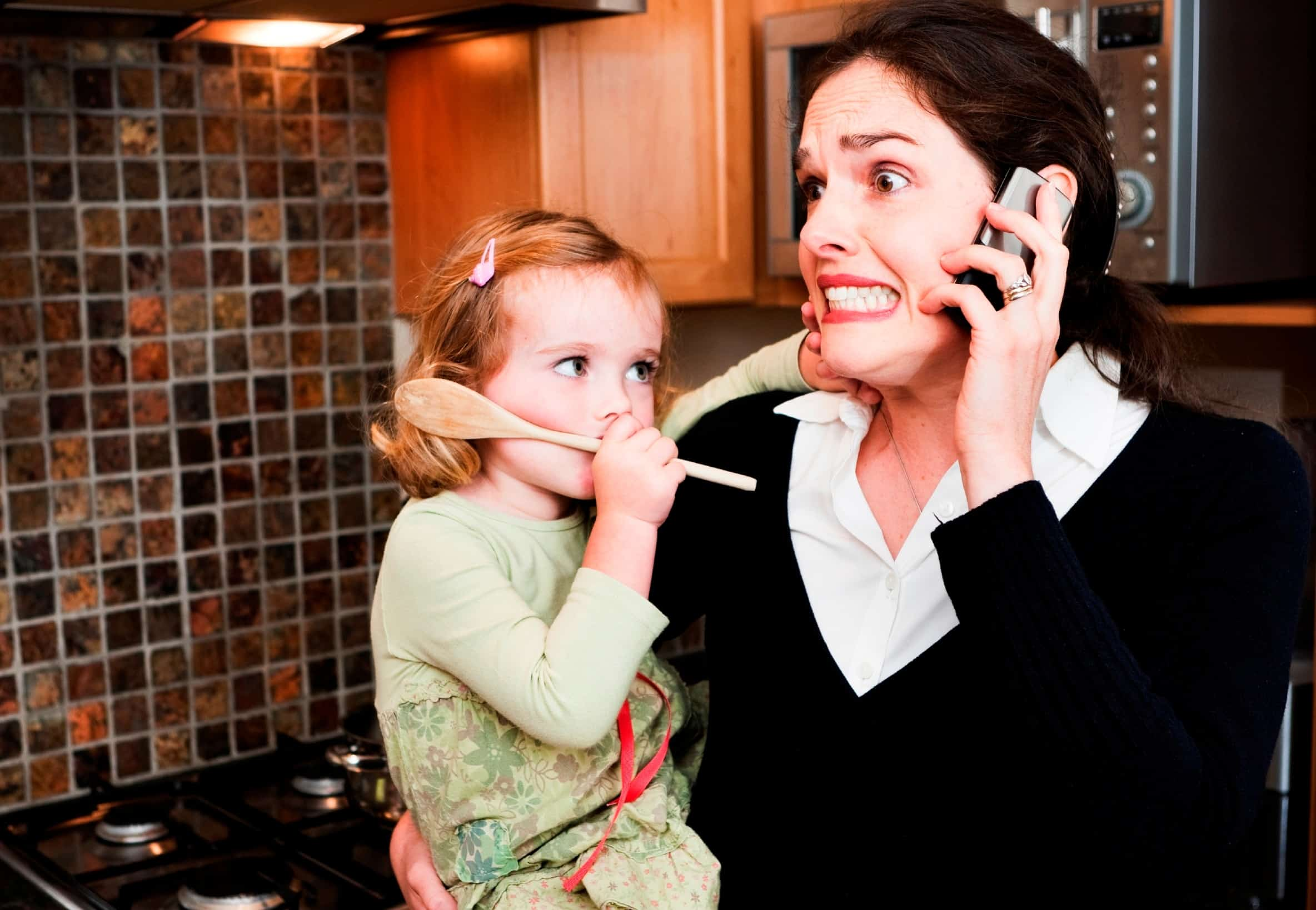Women with toddler calling pest control about ants in the kitchen